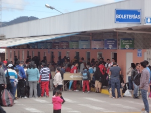 The line for tickets at the bus station.